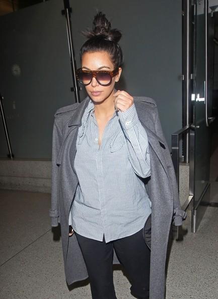 Pregnant Kim Kardashian Arriving On A Flight At LAX