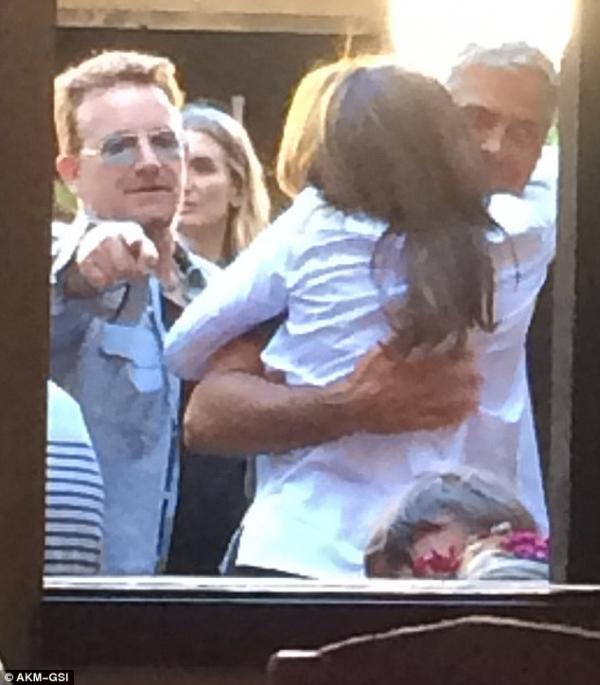 صور جورج كلوني وأمل علم الدين مع سيندي كروفرد 2014