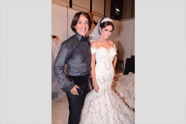صور درة بفستان زفاف أبيض في عرض أزياء هانى البحيرى 8-12-2014