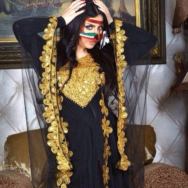 صور حليمة بولند وهي ترتدي برقع مزين بالعلم الكويتي 2015