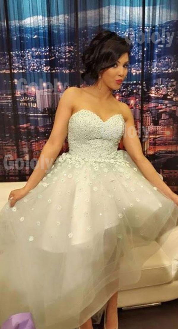 ابتسام تسكت بفستان زفاف ابيض