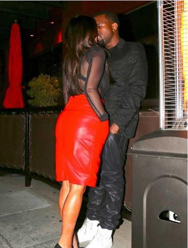بالصور حبيب كيم كارداشيان يخطف قبلة منها في غفلة من شقيقاتها - صور كيم كارداشيان بتنورة حمراء 2013